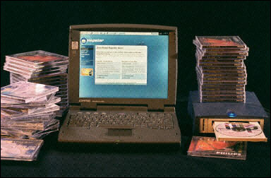 060120135856.528xxpm90_pilas-de-cd-s-junto-a-un-ordenador-b